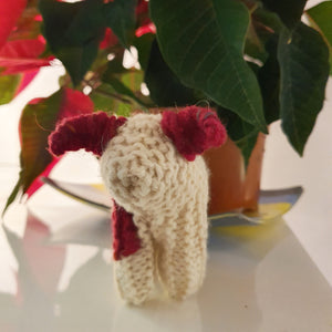 A charming handknitted wool sheep in red and cream, available at Connemara Blue