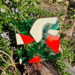 A fused glass coaster in green, red and vanilla, handmade by Connemara Blue. Matching items available online
