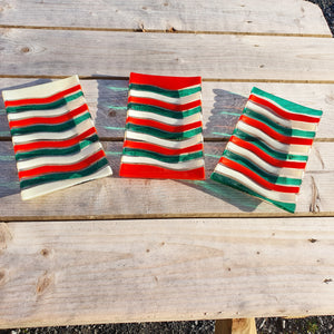 A stripy glass rectangular plate in red, green and vanilla, handmade by Connemara Blue