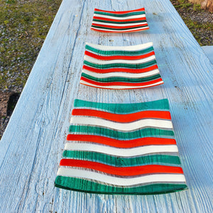 A stripy glass square plate in red, green and vanilla, handmade by Connemara Blue