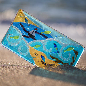 Fused glass panel featuring sea, seaweed, fish and a sailboat, made by Connemara Blue