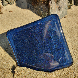 A fused glass coaster in sparkly aventurine blue, handmade by Connemara Blue