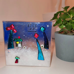A fused glass tealight holder featuring beautiful sparkly glass in the form a fairy garden, handmade by Connemara Blue