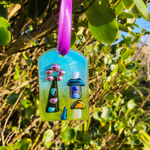 A fused glass hanging decoration based on a magical spring fairy garden theme, with shiny dichroic glass on a translucent powdered background. A lovely romantic, Valentine's, or small gift idea, handmade by Connemara Blue