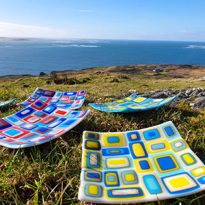 A collection of fused glass stacked plates, handmade by Connemara Blue
