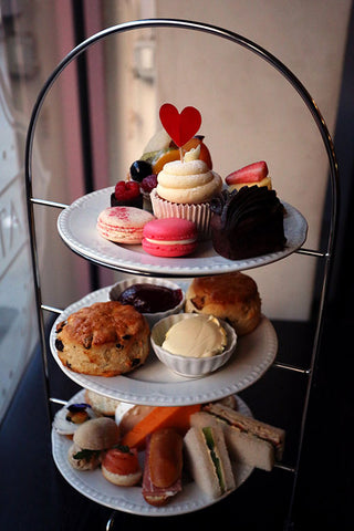 A high tea stand laden with treats.
