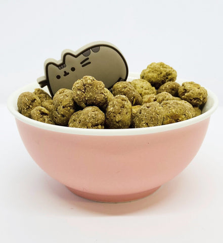 A bowl of fishy catnip treats for cats.