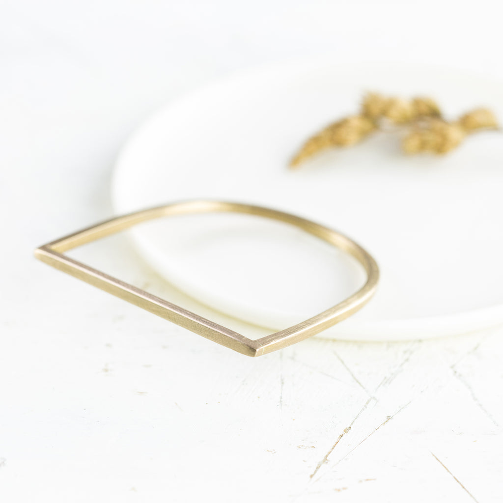 Brass Chunky D Bangle by Clare Elizabeth Kilgour