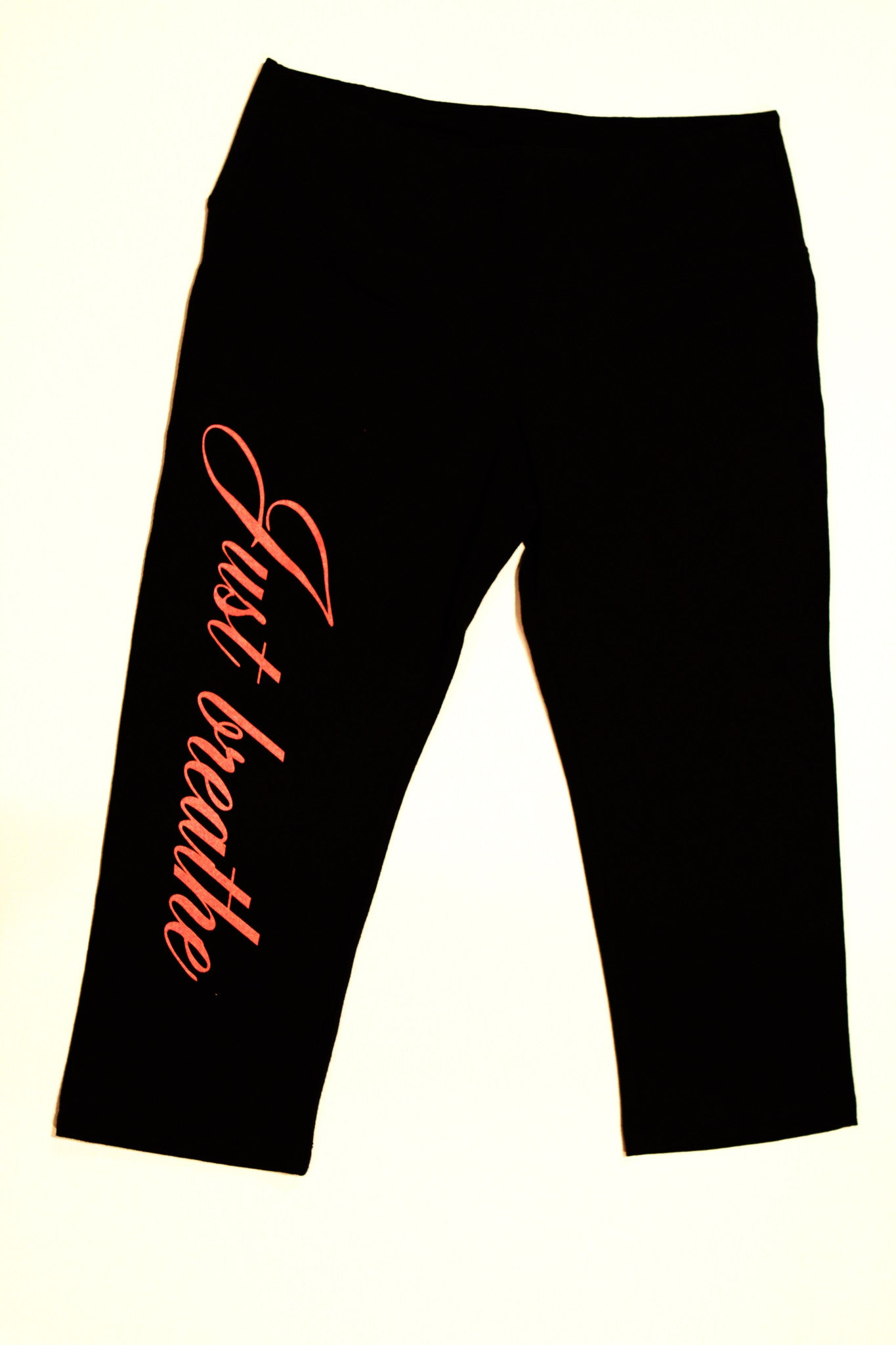 "Yoga/Capri Pants/Knee Length with""Just breathe"" on Leg in Pink."