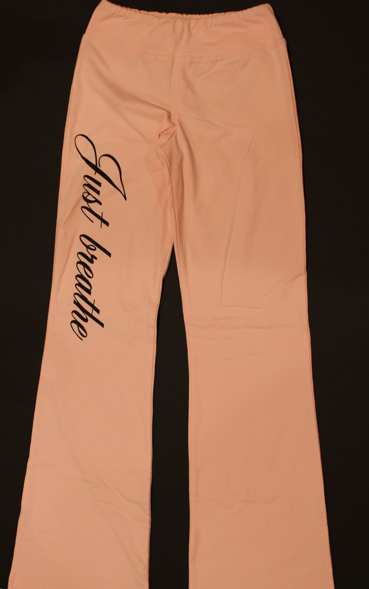 "Yoga/Fitness Pants in Pink with ""Rockstar"" on rear and ""Just breathe"" on the leg"