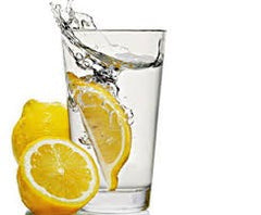 Lemon wedge in water