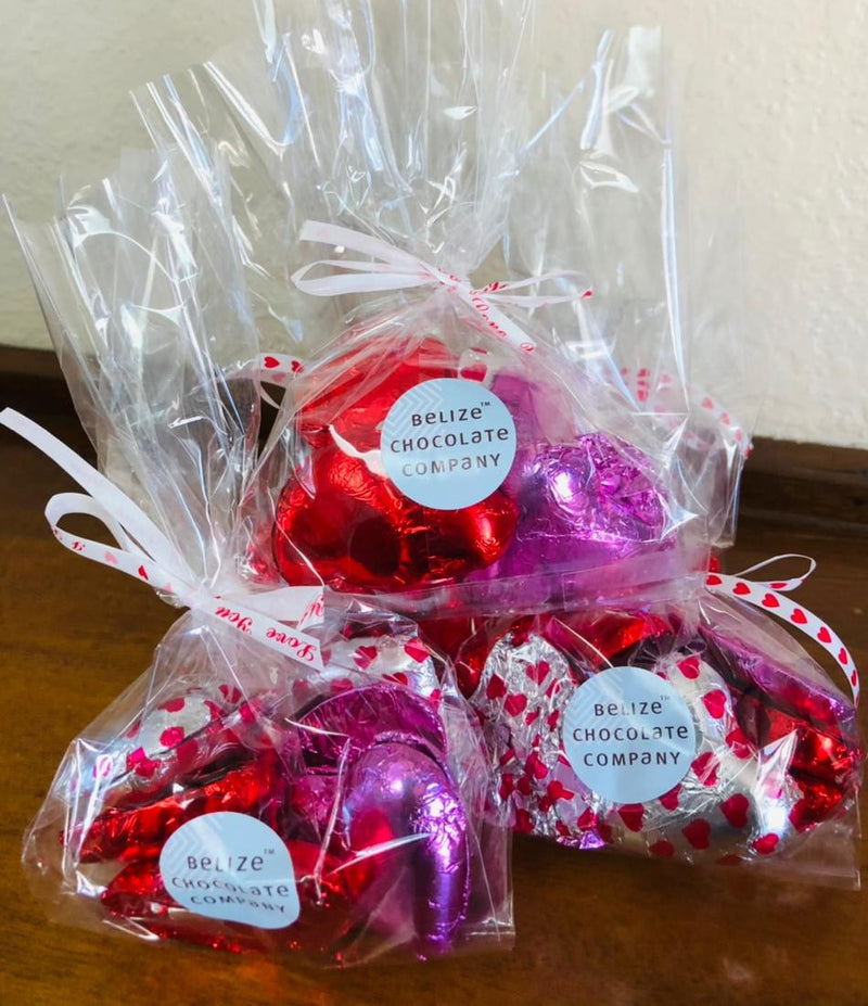 dark,milk, and white chocolate hearts in colored foil in cellophane bag