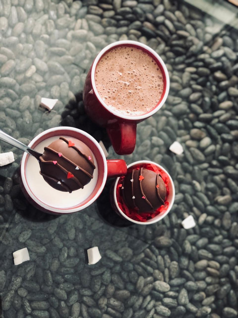 hot chocolate bomb in red mug