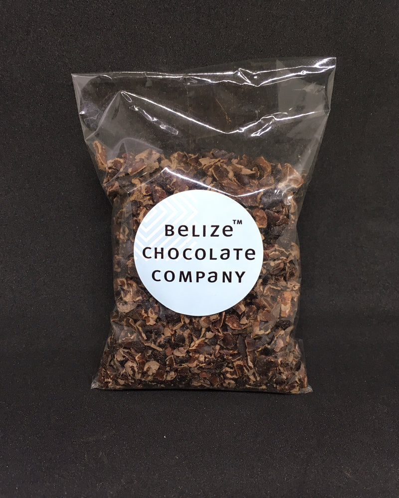 Two ounce pack of organic roasted cacao nibs sealed in a cellophane packet