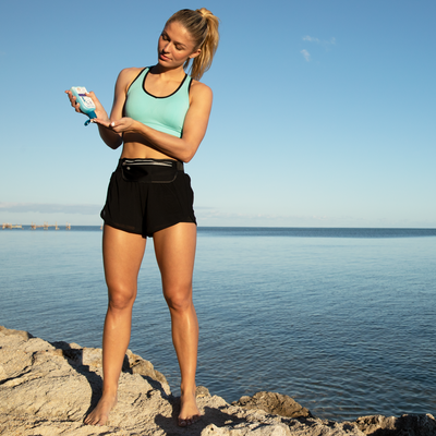 Woman preparing for run with Blue Lizard Sunscreen Sport Mineral-Based Sunscreen SPF 30+