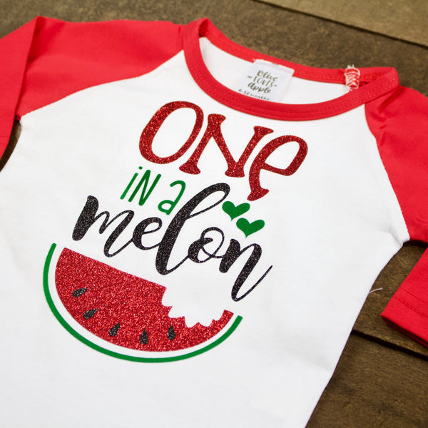 Red One in a Melon Red Raglan Shirt