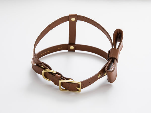 Saddle brown leather harness with removable bow