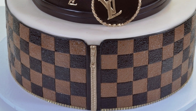 1906 – Louis Vuitton in 3 Tiers