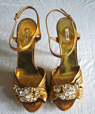 ~ MIU MIU / PRADA GOLD LEATHER & SCULPTED CRYSTAL ANKLE STRAP HEELS ~ 40