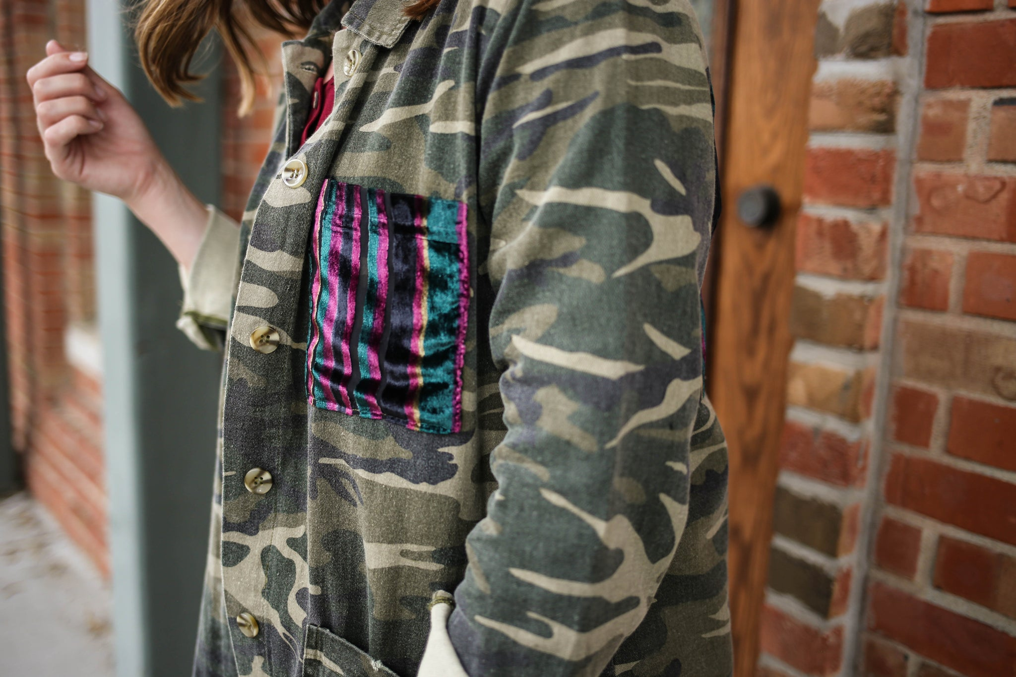 Camo lightweight jacket with purple, blue, and pink velvet front pocket detail