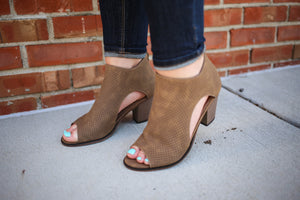 Tan open toe and side cut out heels