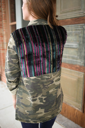 Back detail of a camo jacket with blue, pink, and pink shoulder panel detail.