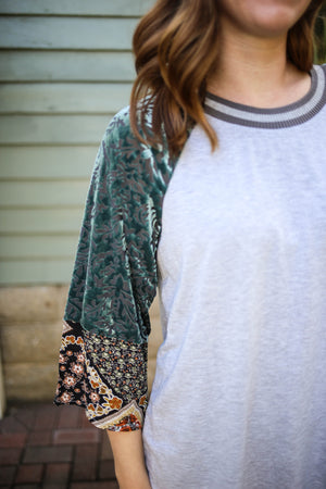 Teal blue velvet burnout paisley and floral print sleeve detail
