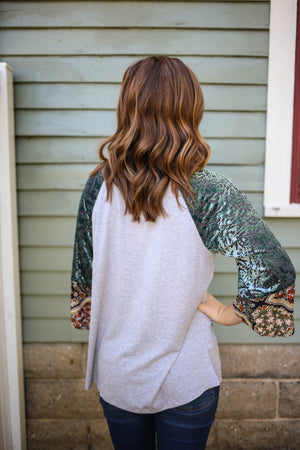 Heather grey top with velvet burn out and floral print sleeve detail