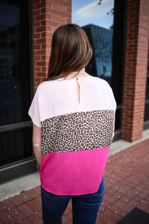 pink and animal print colorblock short sleeve top