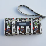 Strange & Unusual | The Necessary Clutch Wallet with Wristlet Strap