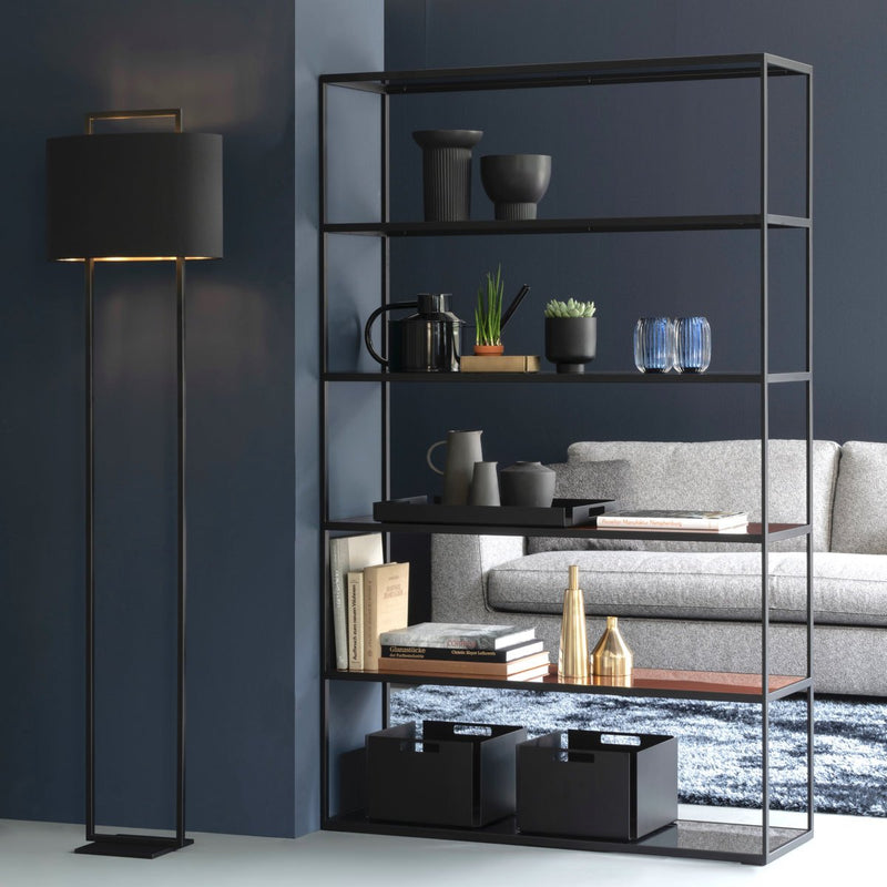 black room divider with black storage boxes