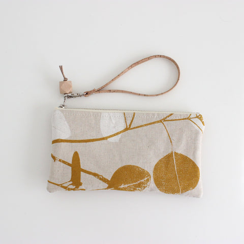 The Small Clutch in Silver Dollar Gum Yellow Ocher