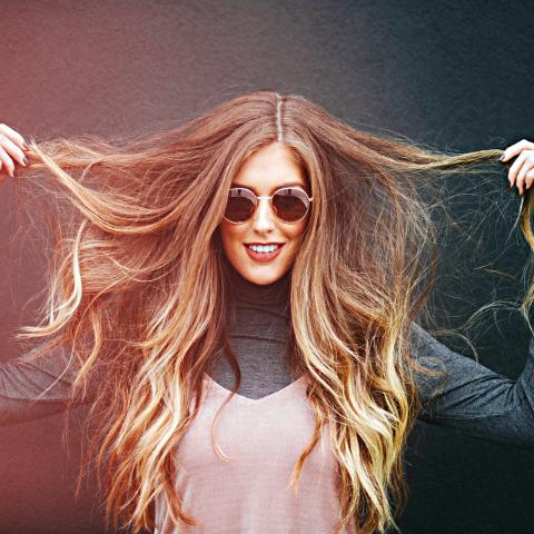 Girl with long hair and sunglasses