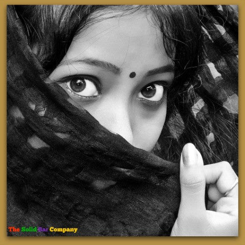 Image of a pretty Indian girl's eyes as she is hiding her face