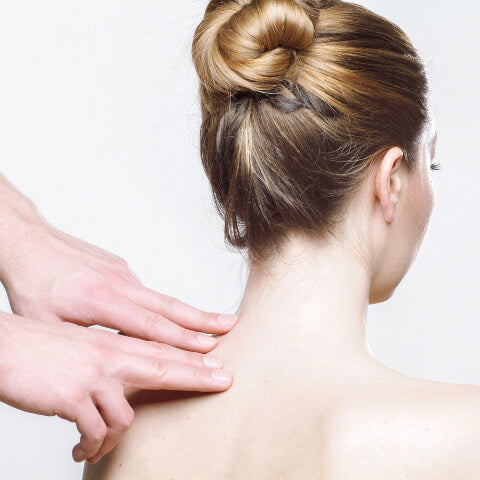 Woman having neck massaged
