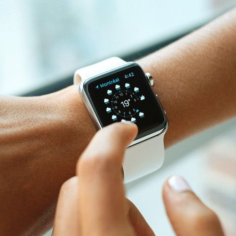 Woman looking at an apple watch