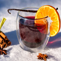 Mulled wine in a glass with spices