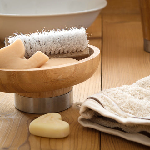 Soap, towel and scrub brush for bathroom