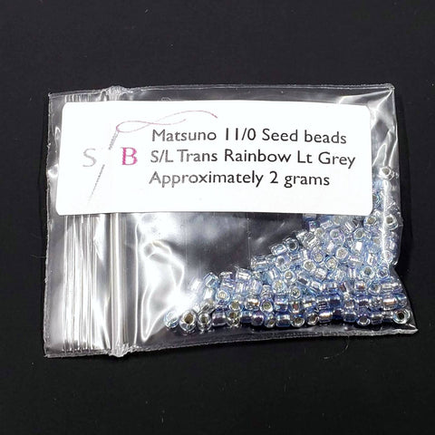 Matsuno 11/0 Seed Beads - Transparent Light Grey Rainbow