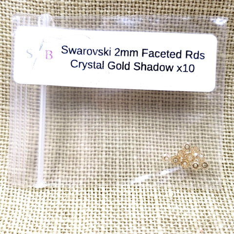 Swarovski 2mm Faceted Rounds - Crystal Gold Shadow