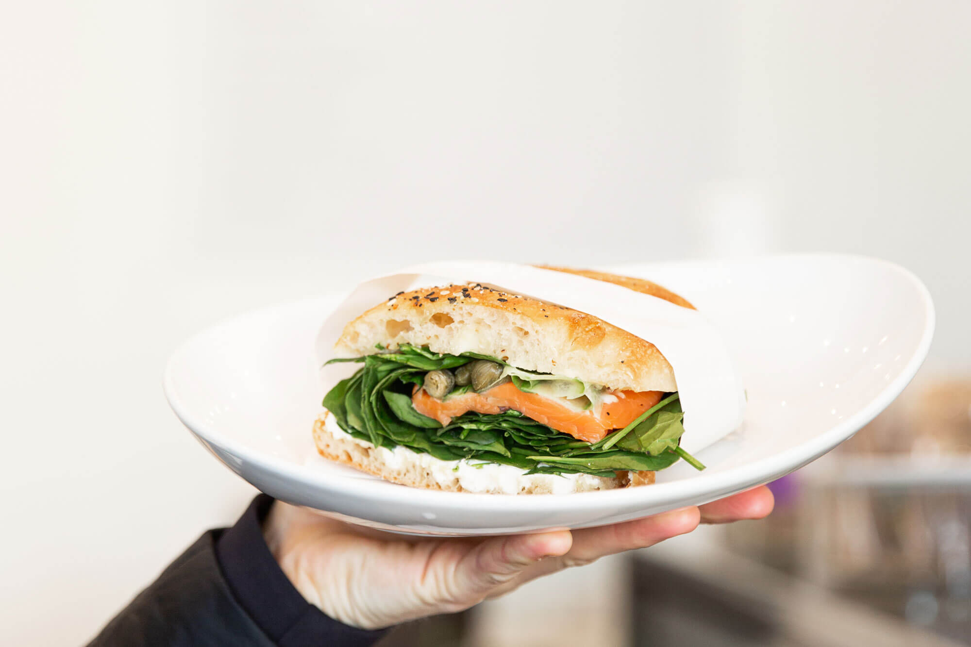 Person holding sandwich from Catroux Cafe Auckland