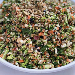 Raw detox salad with cauli, broc, carrots, kale, currants, almonds, lemon, seeds GF, DF, VEGAN