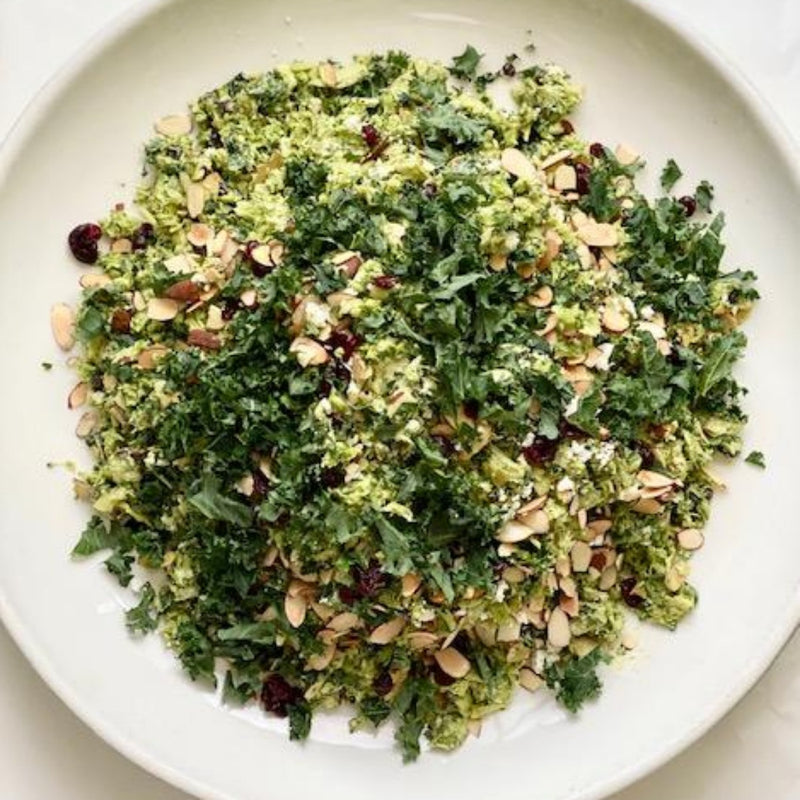 Raw broccoli, cranberries, almonds, artichoke, feta, tahini dressing, parsley GF