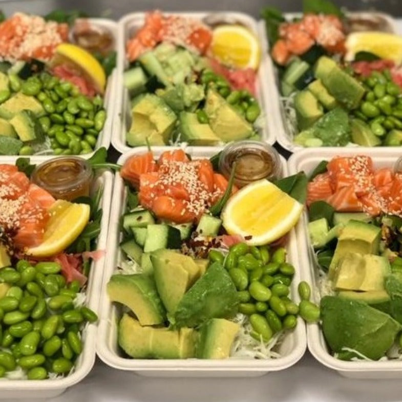 Salmon poke lunchbox with avocado, cucumber, edamame, sesame dressing, yum yum sauce, cabbage GF