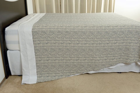 Netting oversized cotton blanket grey ecru side view hang excess comfort made in portugal
