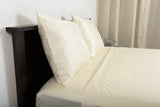 Supreme sateen egyptian cotton sheets ivory top side view by excess comfort made in usa of fabric made in israel