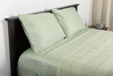 Supreme sateen egyptian cotton sheets sage with abside cotton blanket green white top side view by excess comfort