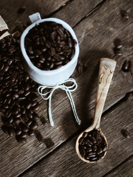 dreamware wooden scoop with organic fair trade coffee beans.