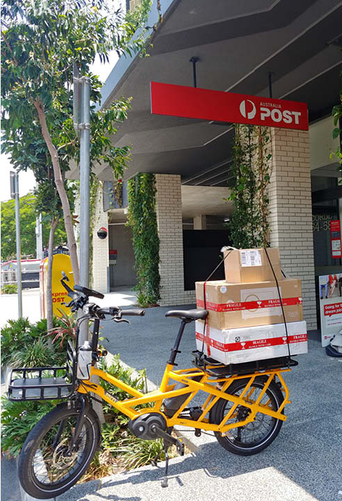 Tern GSD cargo electric bike collecting post from the post office