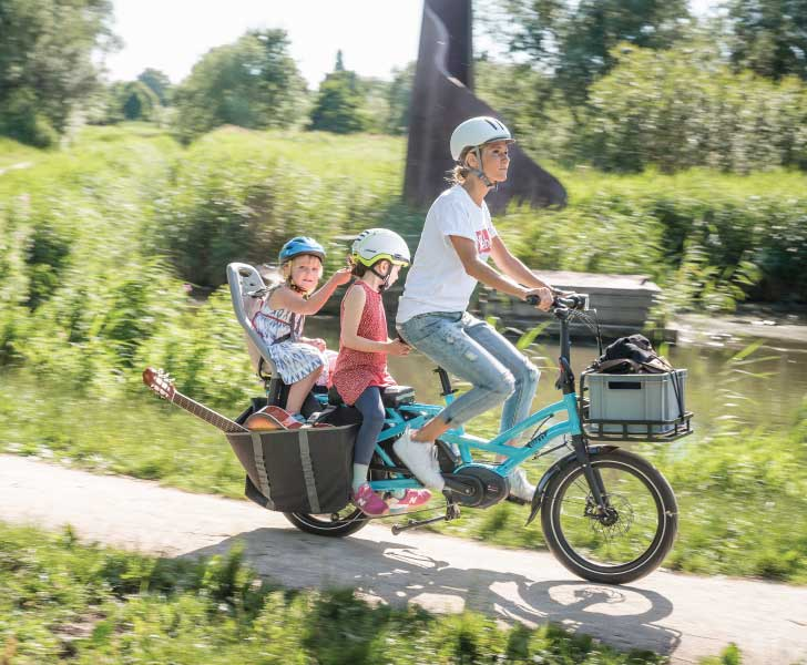 Tern Electric Cargo Bike - Woman Riding with Two Kids